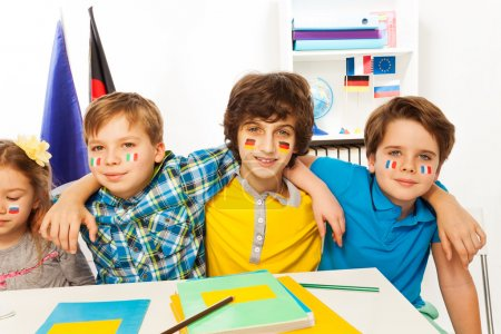 Pupils with flags on cheeks