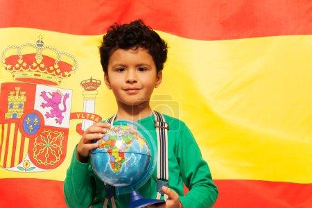 boy learn geography with globe