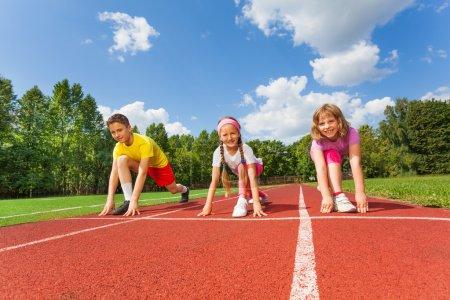 Three children ready to run