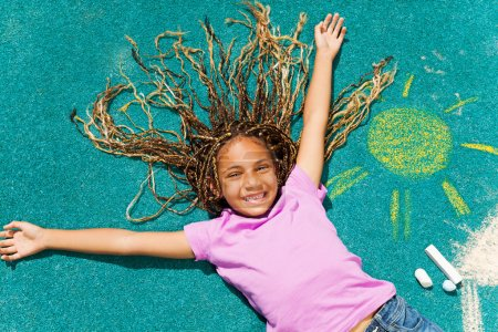 Black girl with chalked drawing