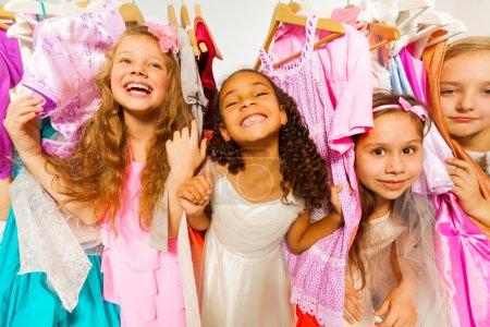 Laughing girls among dresses