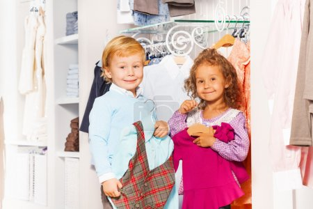 Girl and boy in clothes store