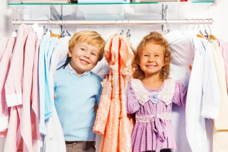 Boy and girl play hide-and-seek in clothes