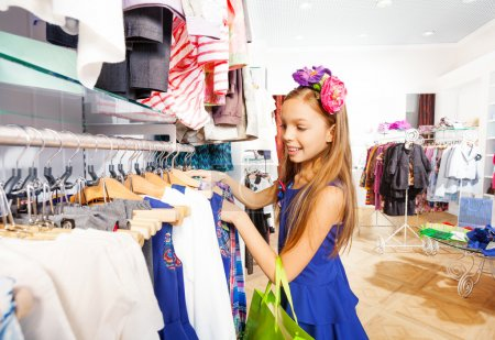 Girl with flower accessory in shop