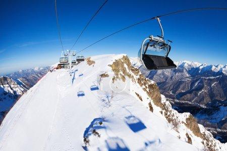 Ski lift chairs over the mountain peak