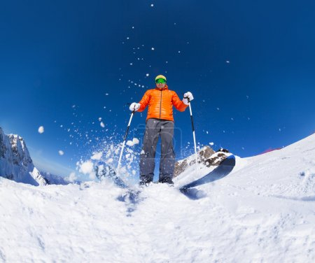 Man with ski mask skiing in mountains