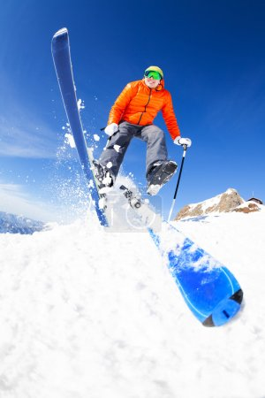 Young man in jump while skiing