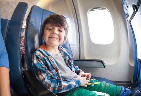 Little boy in airplane seat