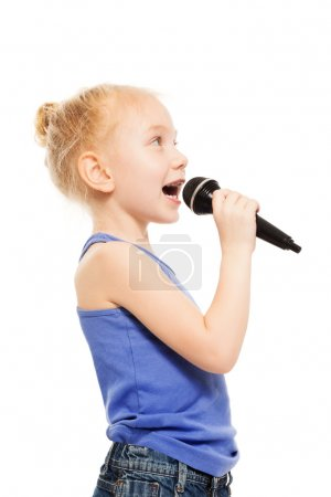 small girl singing in microphone