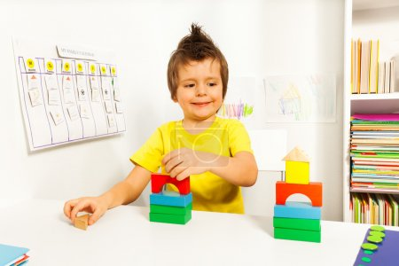 Smiling boy replicating example with blocks