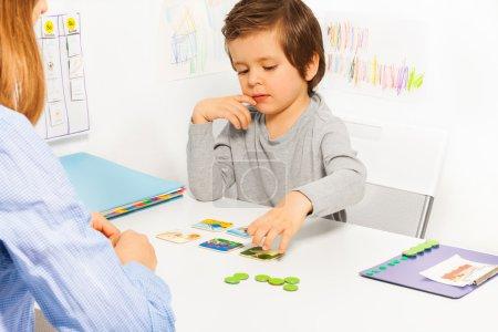 Preschooler boy plays in developing game