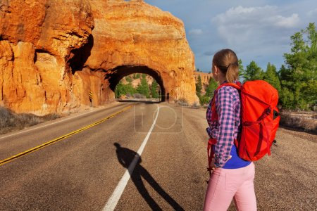 girl with rucksack near Red canyon