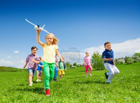 happy running kids with airplane toy