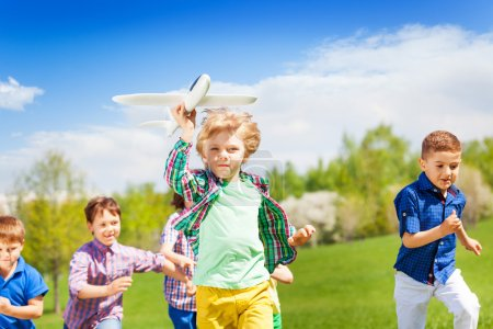 happy running children with airplane toy
