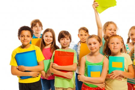Photo for Happy group of classmates standing together with textbooks smiling isolated on white - Royalty Free Image