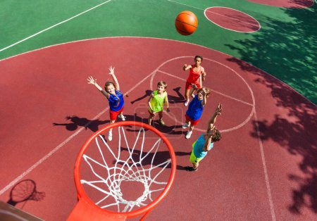 Flying ball to basket top view during basketball