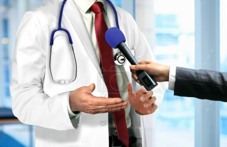 Doctor Talking to Microphone