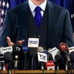 Politician at Press Conference...