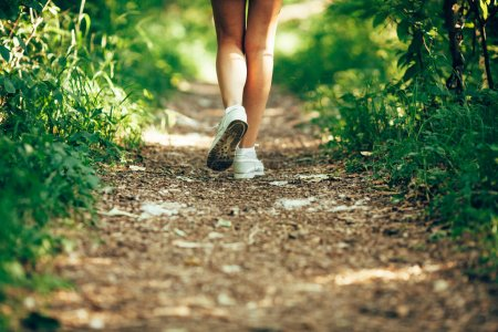 Photo for Closeup woman runner shoe on park trail - Royalty Free Image