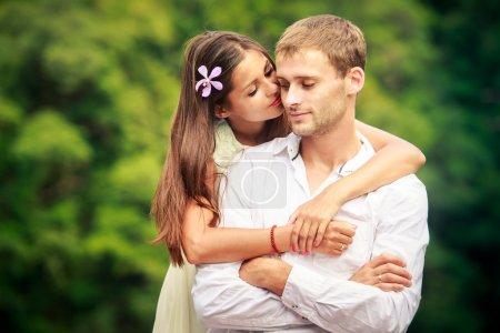 Bride hugging handsome groom