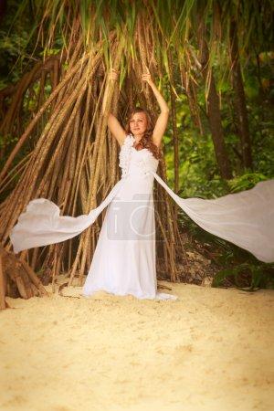 Bride in posing on beach
