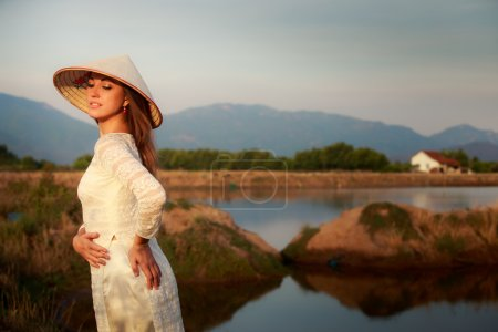 Photo for European beautiful  girl in Vietnamese hat rear view - Royalty Free Image