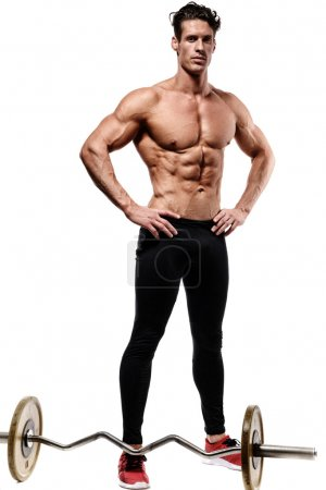 Muscular and fit young bodybuilder posing demonstrates the core