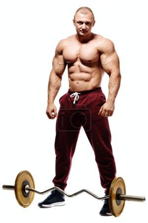 Handsome muscular bodybuilder preparing for fitness training.
