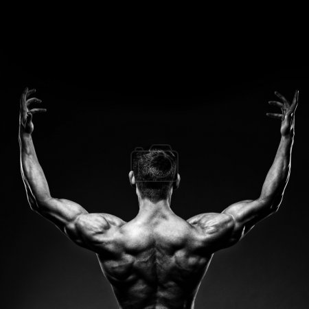 bodybuilder posing and turned his back