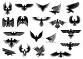 Heraldic black eagles falcons and hawks set spread wings isolated on white background