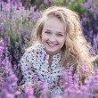 Beautiful small blond girl on the lavender field...