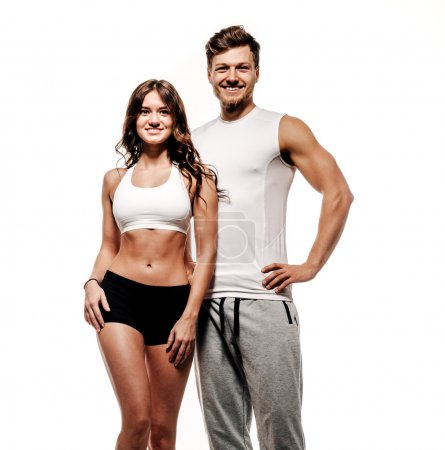 Photo for Young and beautiful athletic woman and man on white background - Royalty Free Image