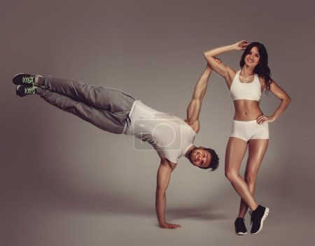 Young athletic couple, studio shot
