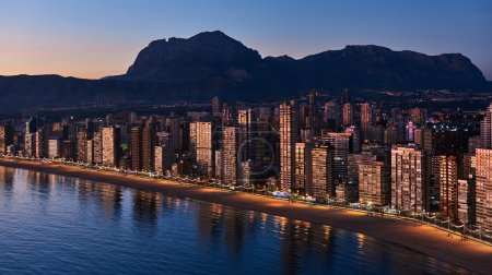 Aerial view of a Benidorm city coastline at sunset...