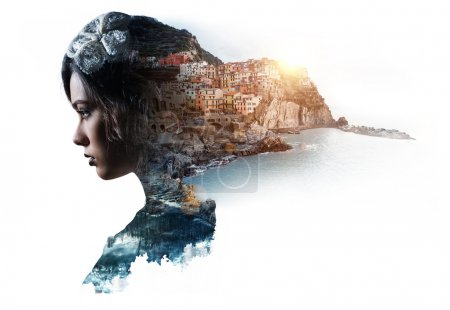 Double exposure portrait of a woman and view of Manarola