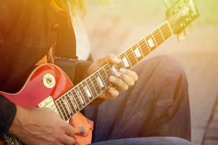 Photo for Man playing guitar on street - Royalty Free Image