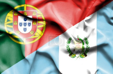 Waving flag of Guatemala and Portugal