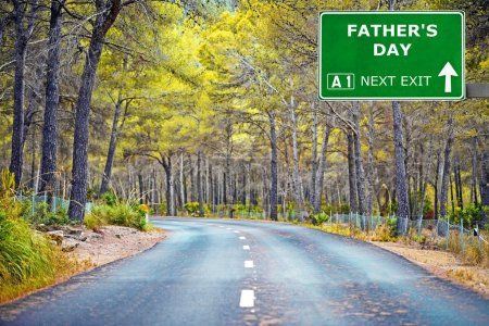 FATHERS DAY road sign against clear blue sky
