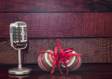Photo for Vintage microphone on old wooden background - Royalty Free Image