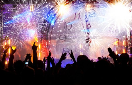 Photo for Clock close to midnight, fireworks and crowd of people waiting for New year - Royalty Free Image