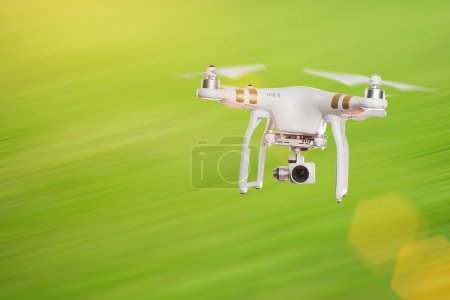Photo for White drone quad copter with 4K digital camera flying. Close-up. - Royalty Free Image