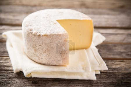 Photo for Delicious camembert cheese on old wooden table - Royalty Free Image