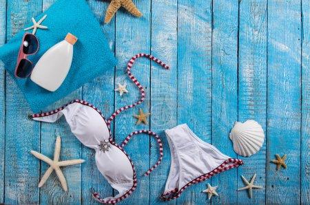 Summer beach accessory on the wood table.