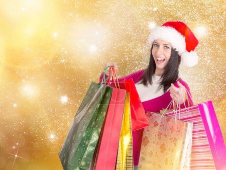 Photo for Young beautiful woman with some shopping bags - Royalty Free Image