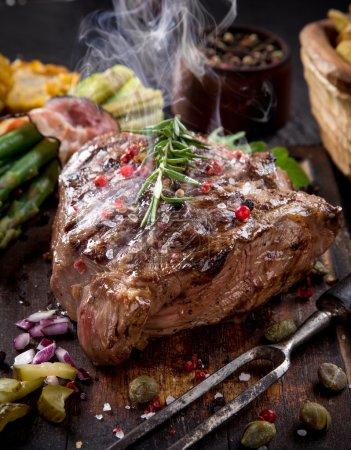Beef steak on stone table