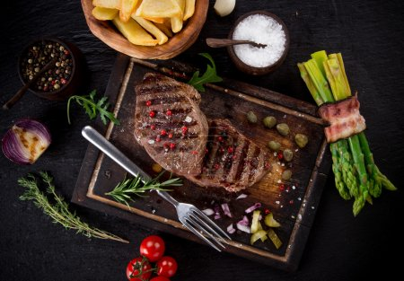 Photo for Delicious beef steak on stone table, close-up - Royalty Free Image