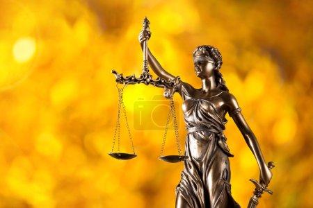 Themis in spotlight, law concept.