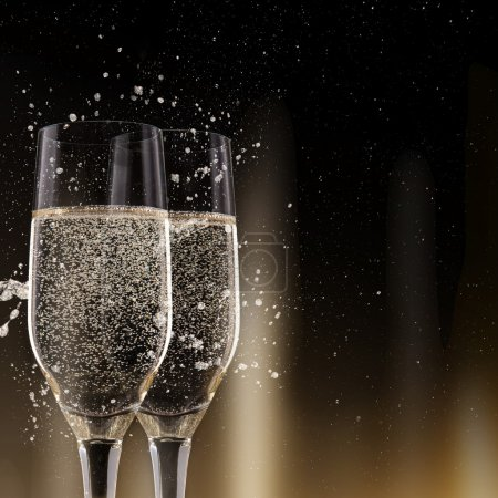 Champagne flutes on black background