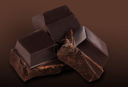 Brown chocolate bar on dark brown background...