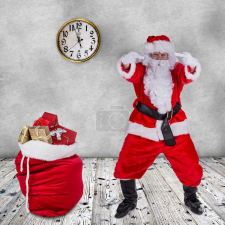 Photo for Santa Claus with upraise middlefingers, concept of Christmas hatred. - Royalty Free Image